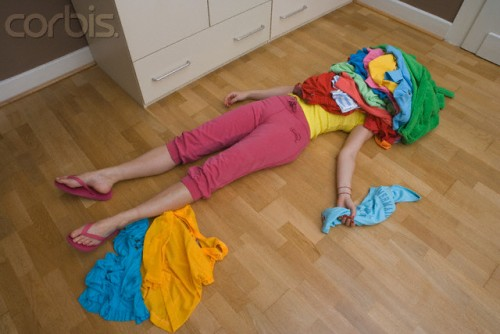 Woman Buried Under Dirty Clothes